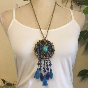 Handcrafted beaded medallion tassel necklace